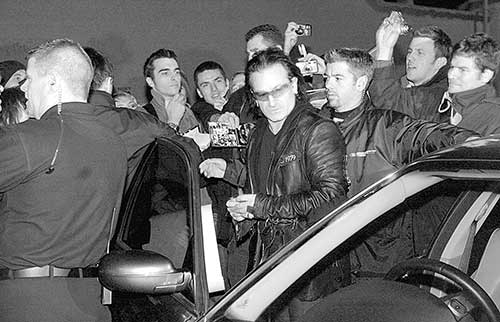 Bono's Bodyguard's working hard to handle the crowds during an embus